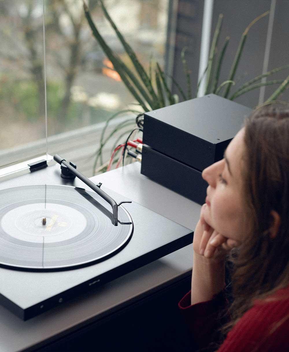 Girl enjoying music retro setup turntable