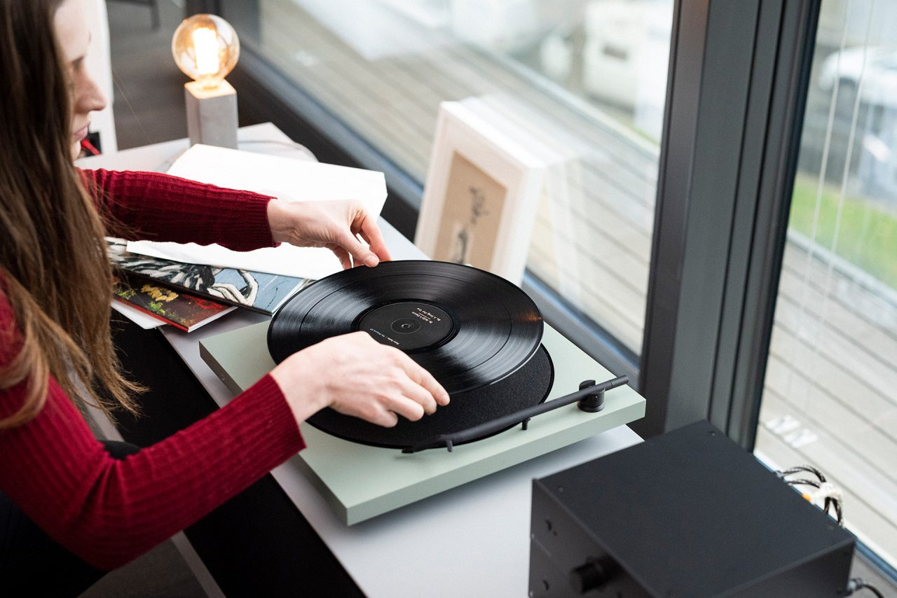 Playing a record on a TONE FACTORY turntable.